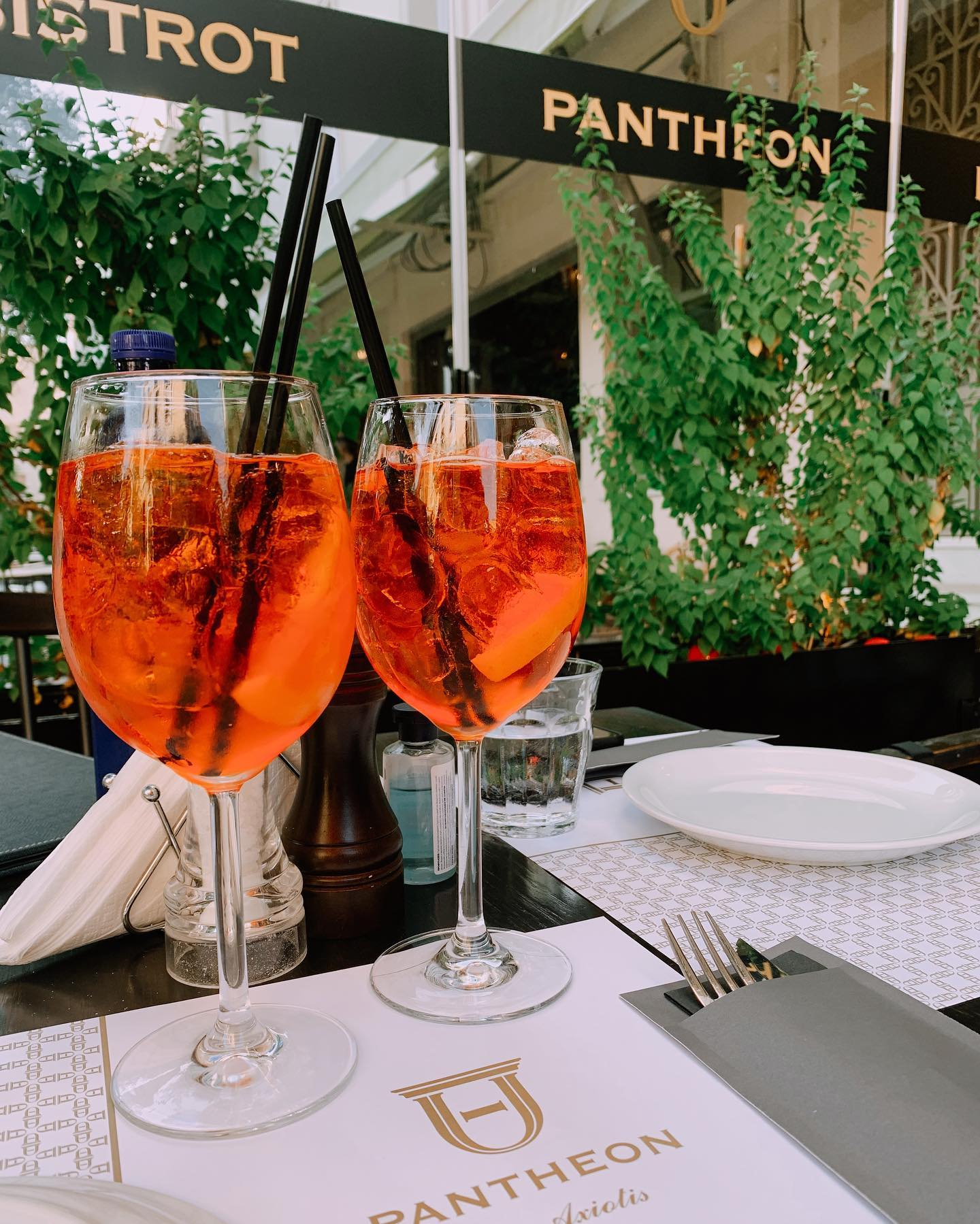 Two aperol spritz at Pantheon Restaurant in Athens, Greece